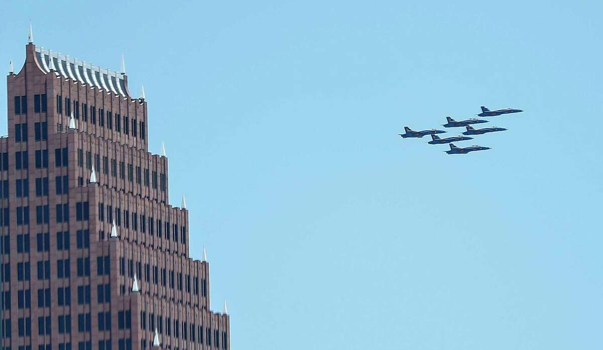 The Blue Angels' America Strong flyover passes the Bank of America building in Houston, Wednesday, May 6, 2020. Photographed from the top deck of Skyhouse Houston on Main Street. The 30-minute flyover was a salute to frontline COVID-19 responders.