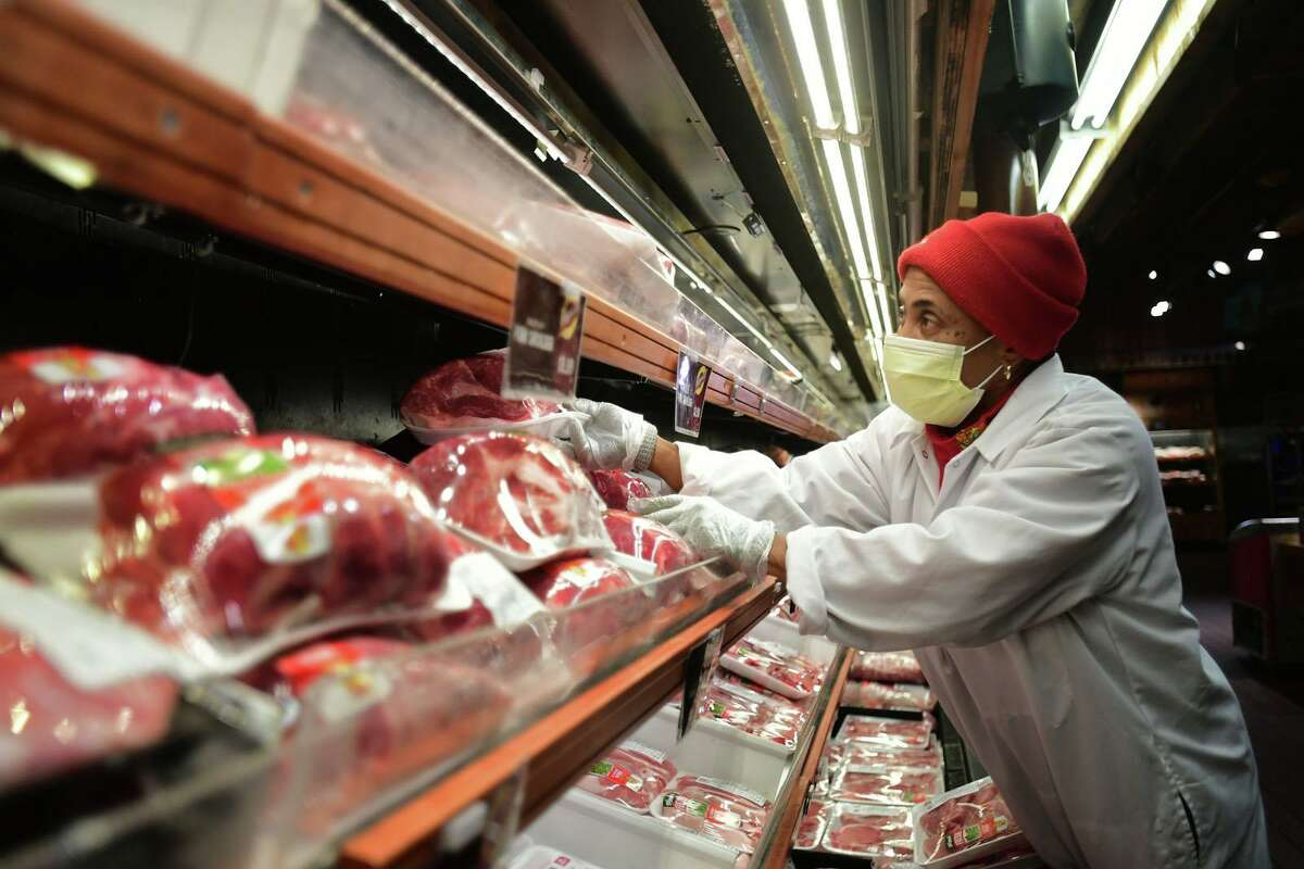 A Stew Leonard's employee stocks meat on May 6, 2020, at the company's flagship Norwalk, Conn.
