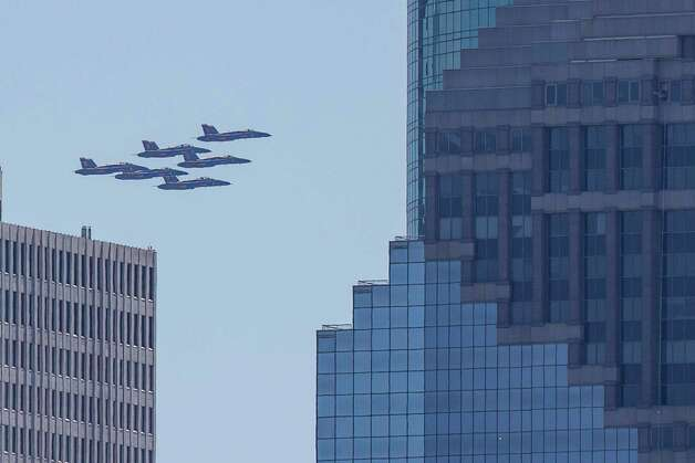 The U.S. Navy Blue Angels fly past downtown as seen from  over the Buffalo Bayou, Wednesday, May 6, 2020, in Houston. Photo: Mark Mulligan, Staff Photographer / © 2020 Mark Mulligan / Houston Chronicle
