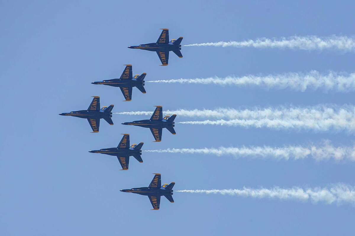 The U.S. Navy Blue Angels fly past downtown as seen from over the Buffalo Bayou, Wednesday, May 6, 2020, in Houston.