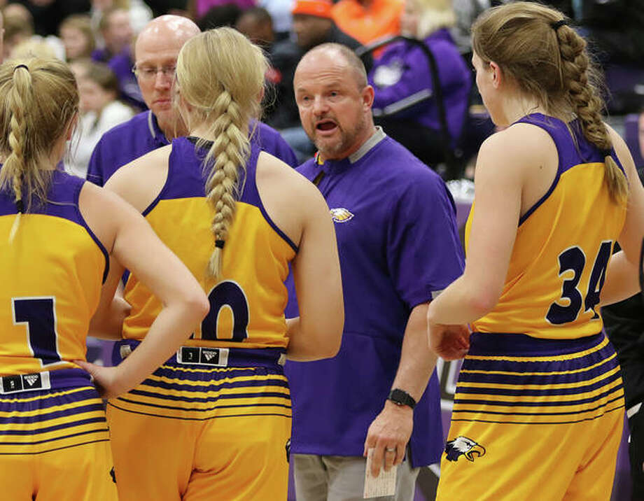 CM coach Jeff Ochs (middle right) talks with his team during a timeout in his first game at interim head coach in a Jan. 4 shootout game at Breese Central. Ochs, who went 15-4 at CM, was approved Wednesday as the new girls basketball coach at East Alton-Wood River. Photo: Greg Shashack / The Telegraph