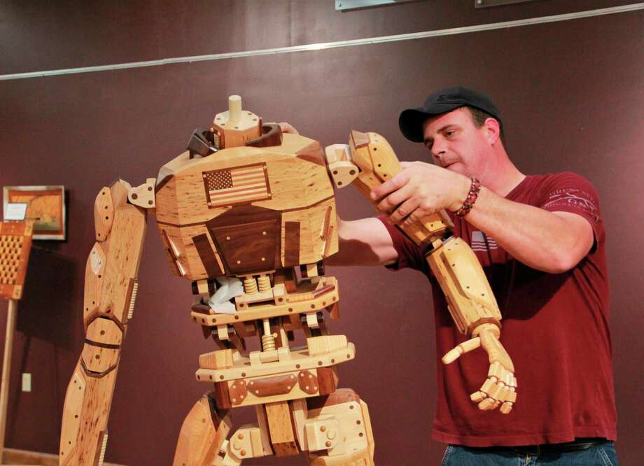 Dan Kaminskiis one of many artists to visit Artworks over the years. Here, he put together his wooden sculptures for their October exhibit, The Four Natural Elements. This year, Artworks is celebrating its 20th year in Big Rapids. (Pioneer file photo)