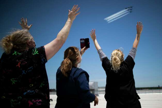 Harris County Jail clinic medical staff Shannon Kloeber, Cathy Rossi, and Beverly Howard wave at the United States Navy's Blue Angels from the rooftop of the county jail as they fly by on Wednesday, May 6, 2020, in Houston. Photo: Marie D. De Jesús, Staff Photographer / © 2020 Houston Chronicle