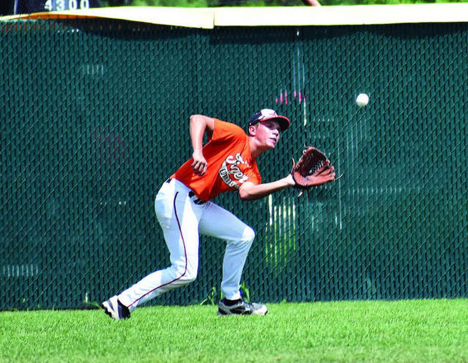 Edwardsville right fielder Nick Logan makes a running catch during a semifinal game against BNBA Gold Hawk/Pax at Tom Pile Field in 2018. Photo: Matt Kamp|The Intelligencer