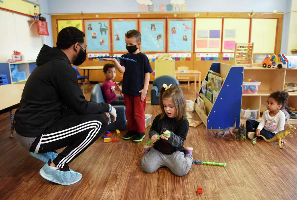 Jordan Rose watches over students, from left, Pierce Faida, Nico Judge, Virginia Myslinski, and Kendra Glaude at the YMCA of Greenwich Early Learning Center on April 29. The YMCA joined the state's CTCARES program to offer free child care services for Greenwich Hospital employees.