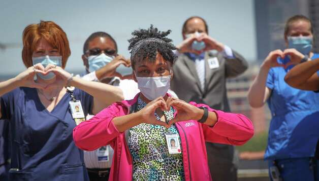 Medical workers wanted to send a message to the United States Navy's Blue Angels after they performed a flyover the Medical Center Wednesday, May 6, 2020, in Houston. The Blue Angels flew over the area in tribute to frontline workers. Photo: Steve Gonzales, Houston Chronicle / Staff Photographer / © 2020 Houston Chronicle