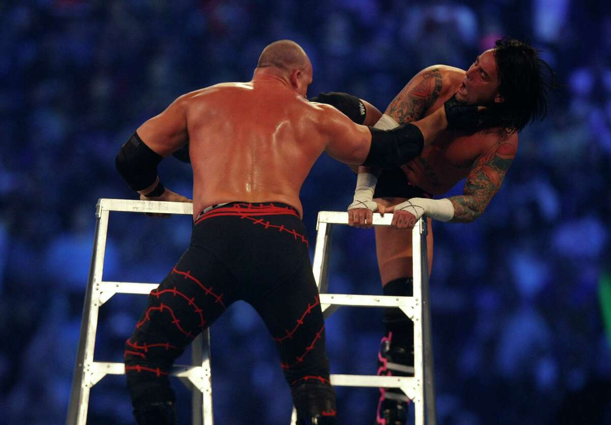 WWE wrestler CM Punk, right, tries to knock down his final opponent, Kane, during the Money in the Bank Ladder Match during the 25th anniversary of Wrestlemania held at Reliant Stadium on Sunday, April 5, 2009, in Houston. For the 2020 Money in the Bank, WWE shot the ladder matches at its headquarters in Stamford, Conn.