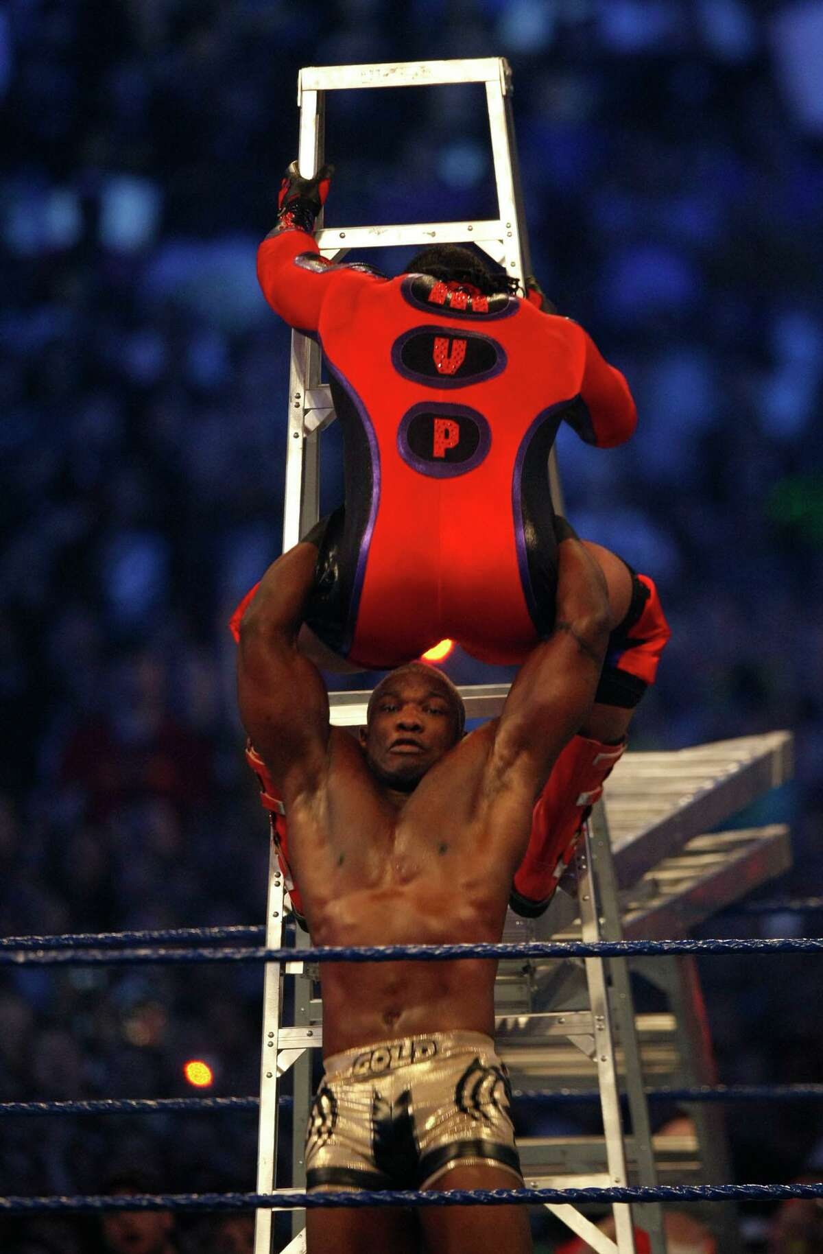 WWE wrestler Shelton Benjamin, also known as Gold Standard, bottom, brings down MVP during the Money in the Bank Ladder Match during the 25th anniversary of Wrestlemania held at Reliant Stadium on Sunday, April 5, 2009, in Houston. For the 2020 Money in the Bank, WWE shot the ladder matches at its headquarters in Stamford, Conn.