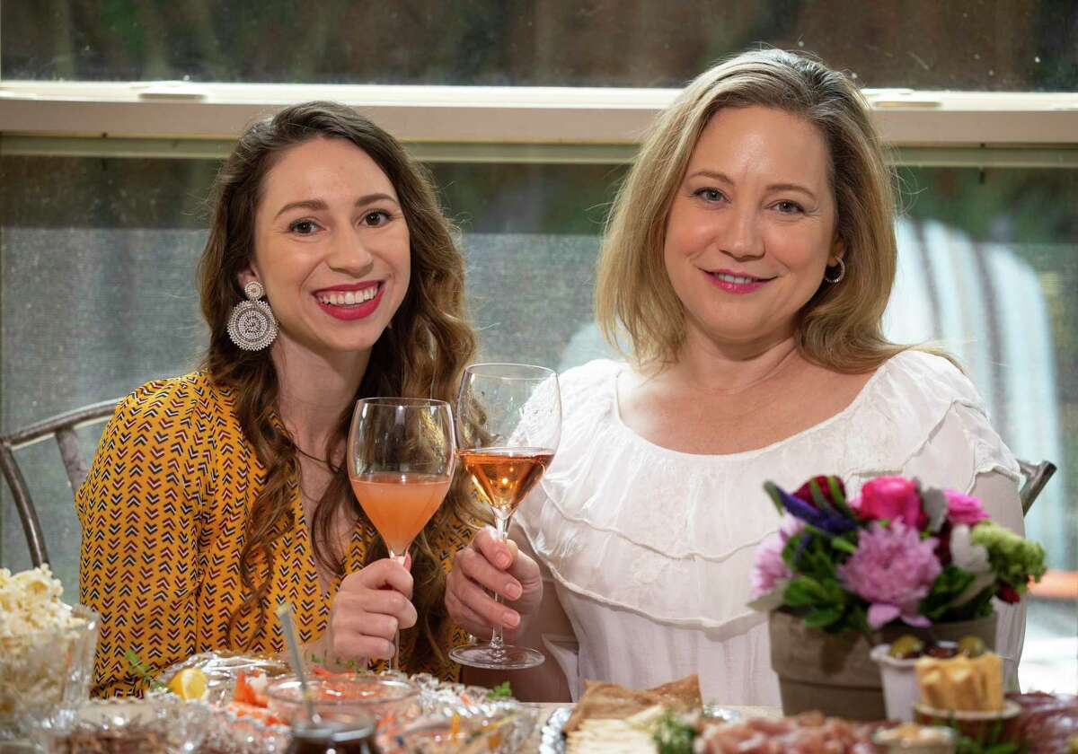 Sandra Crittenden, right, and her daughter Morgan Merovitch pose as toasting each other with their sparkling rose wines Wednesday, April 29, 2020, at their house in Sugar Land. Crittenden was holdling a glass of Mailly Grand Cru Rose de Mailly while Merovitch is holding a glass of William Chris Petillant Naturel Rose.