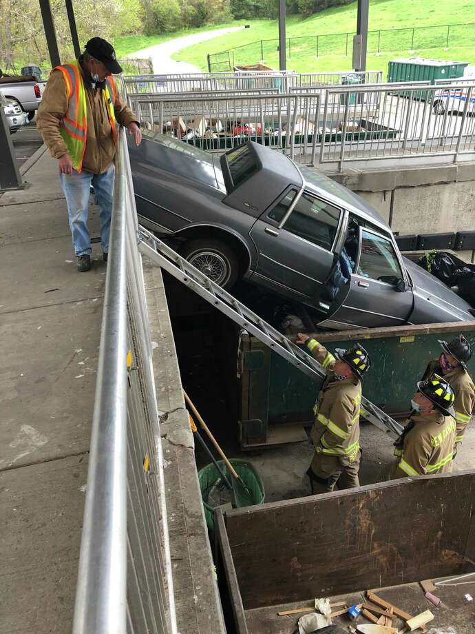 A car is stopped after driving forward over a curb, through a railing and into a trash container at the New Canaan transfer station on Wednesday, May 6, 2020. Photo: Don Smith / Contributed Photo / New Canaan Advertiser Contributed