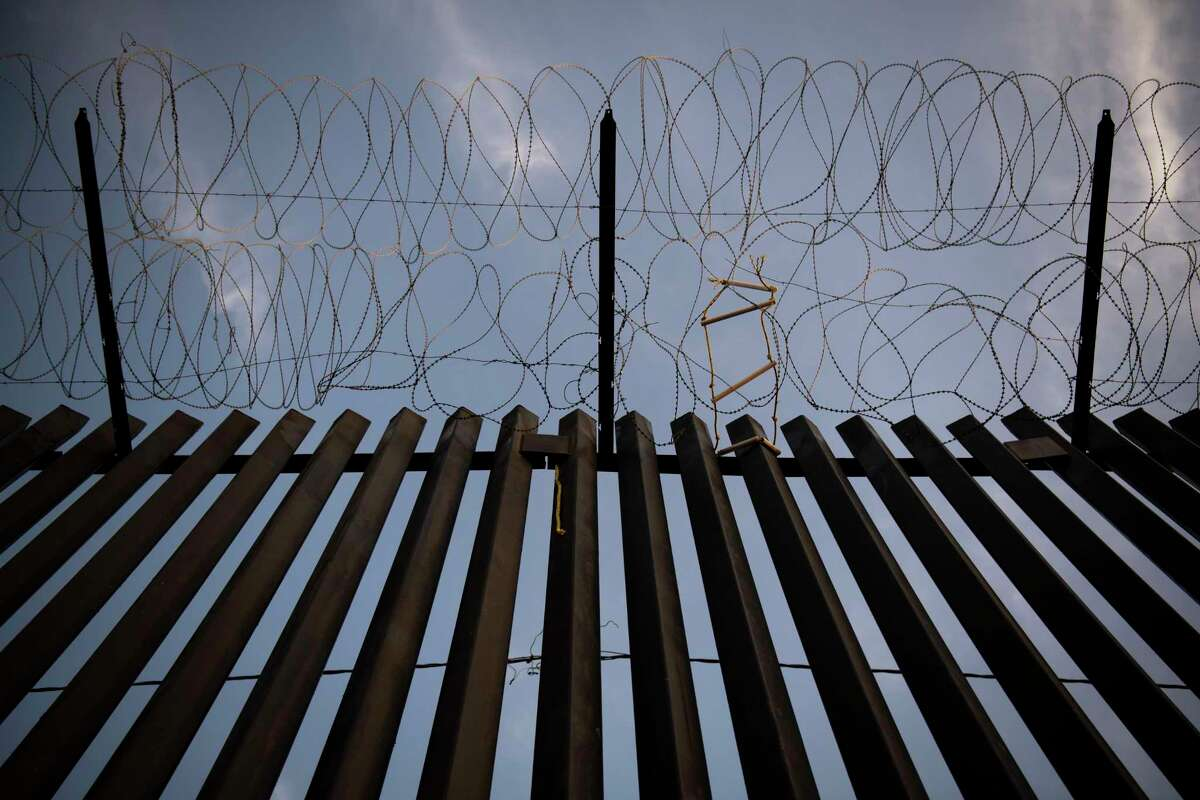 A section of President Donald Trump's border wall that has been painted black near downtown Calexico, which sits on the border between the United States and Mexico, shown in August 2019.