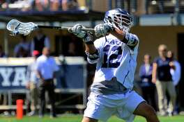 Yale's Brian Tevlin (12) shoots a goal against Georgetown during the First Round of NCAA Division I Men's Lacrosse Championship action in New Haven, Conn., on Saturday May 11, 2019.