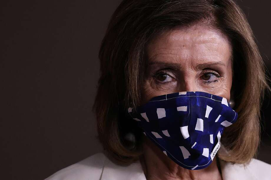 Speaker of the House Nancy Pelosi (D-CA) wears a cloth mask to cover her mouth and nose to prevent the spread of the novel coronavirus during her weekly news conference at the U.S. Capitol April 30, 2020 in Washington, DC. Photo: Chip Somodevilla / Getty Images