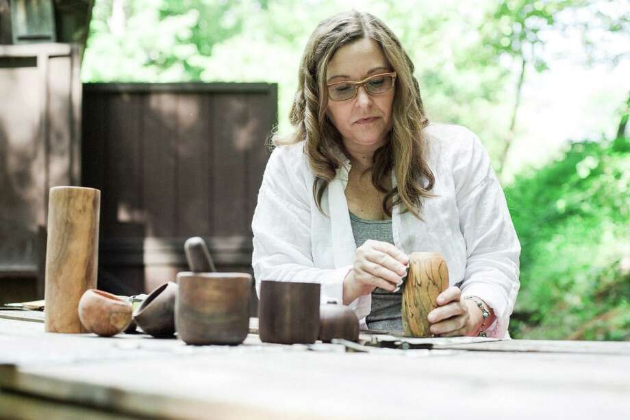 Woodturner Jennifer Hasan works on one of her creations. She has a successful Etsy business and teaches others what it takes to make the site work for them, in online classes offered through Brookfield Craft Center. Photo: Danielle Kol / Contributed Photo