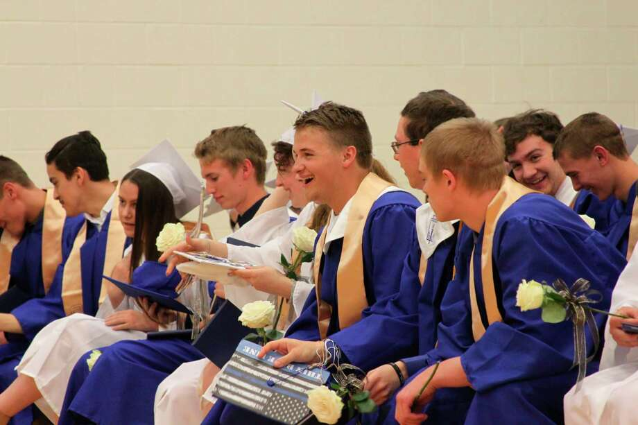 Onekama Consolidated Schools will be like ones all over Michigan holding virtual graduation ceremonies this year at 2 p.m. on May 17 unlike this photograph from the 2019 graduation. However, Onekama School officials have found a safe way for the community to congratulate the graduates with a community parade past the graduates who will be social distancing in the school parking lot at 5:30 p.m. Community members can drive by without leaving their vehicles to congratulate the graduates out the who will be wearing their cap and gowns and social distancing from their classmates. (File photo)