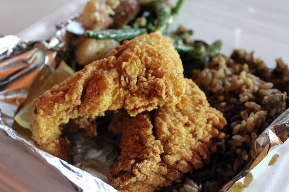 Acadiana Cafe:1289 S.W. Loop 410, 210-674-0019, acadianacafe.com.Will offer family meals feeding up to five. Choices include a half gallon of chicken and dumplings with five servings of bread $18.95, or a pound of fried popcorn shrimp with pint side choices of coleslaw, red beans and rice, mashed potatoes or french fries $21.50; a family meal choice of a half-gallon of red beans, pint of rice, five sausage links, and five breads, $23.25; or a half-gallon of chicken and sausage jambalaya served with five breads $25.65 ; a meal offering of five boneless, marinated baked chicken a breasts with a half-gallon of tossed salad with choice of dressing $27.45; lastly a pound of fried catfish, two side choices and five breads, $29.95 patrons can choose from biscuits, hushpuppies,or cornbread. Photo: Jennifer McInnis /San Antonio Express-News / San Antonio Express-News