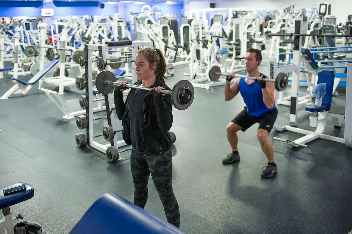 Sam Bandy and Cody Eliason, both of Marysville, workout at Future Fitness in Yuba City, Calif. on Wednesday, May 6, 2020.