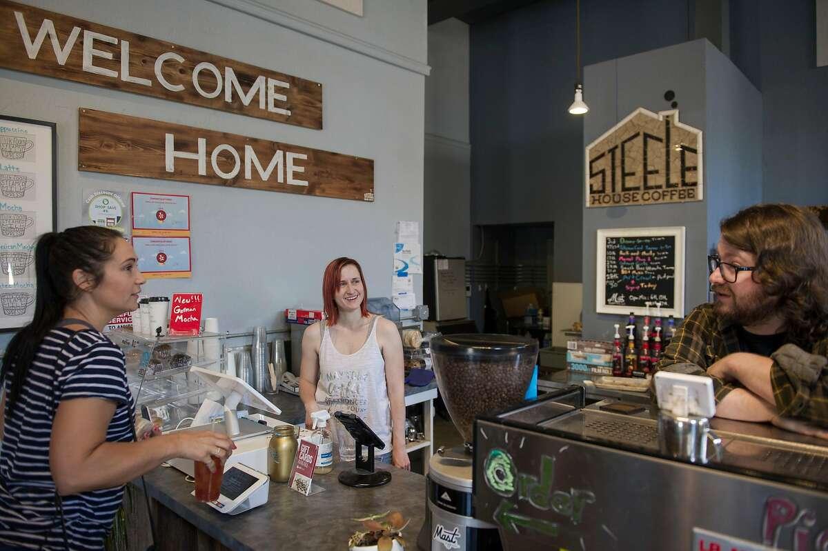 Amanda Rubio, left, of Yuba City talks with Regina and Joe Steele at Steele House Coffee in Yuba City, Calif. on Wednesday, May 6, 2020.