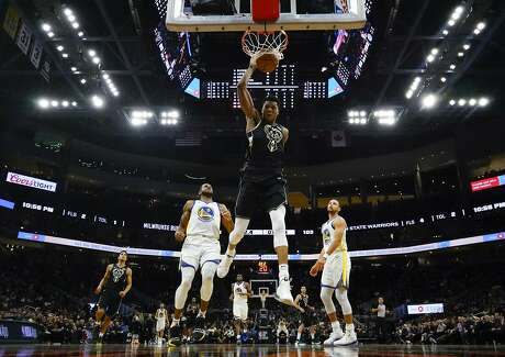 Milwaukee Bucks' Giannis Antetokounmpo dunks during the second half of an NBA basketball game against the Golden State Warriors Friday, Dec. 7, 2018, in Milwaukee. The Warriors won 105-95. (AP Photo/Morry Gash)