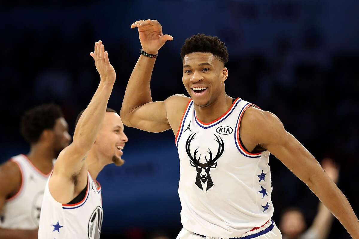CHARLOTTE, NORTH CAROLINA - FEBRUARY 17: Giannis Antetokounmpo #34 of the Milwaukee Bucks and Team Giannis celebrates with Stephen Curry #30 of the Golden State Warriors against Team LeBron in the second quarter during the NBA All-Star game as part of th