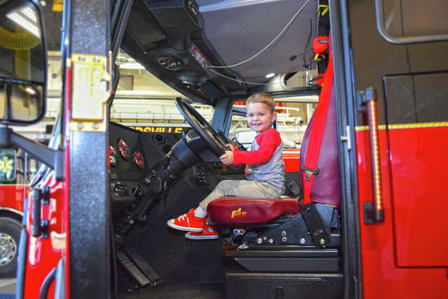 In this February 2020 file photo, Beau Sweetman, son of Edwardsville Fire Department firefighter Tanner Sweetman, checks out the city's newest fire truck as he readies himself for the next call. The truck was one of the accomplishments highlighted by Mayor Hal Patton during the State of the City address Tuesday. Photo: Tyler Pletsch | The Intelligencer