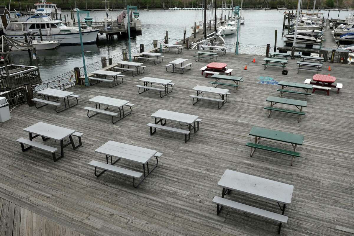 Picnic tables are in place on the dining deck at Captain's Cove Seaport, in Bridgeport, Conn. May 6, 2020. Restaurants will be able to resume outdoor table service starting May 20 during the coronavirus public health emergency, with approval from local municipalities.