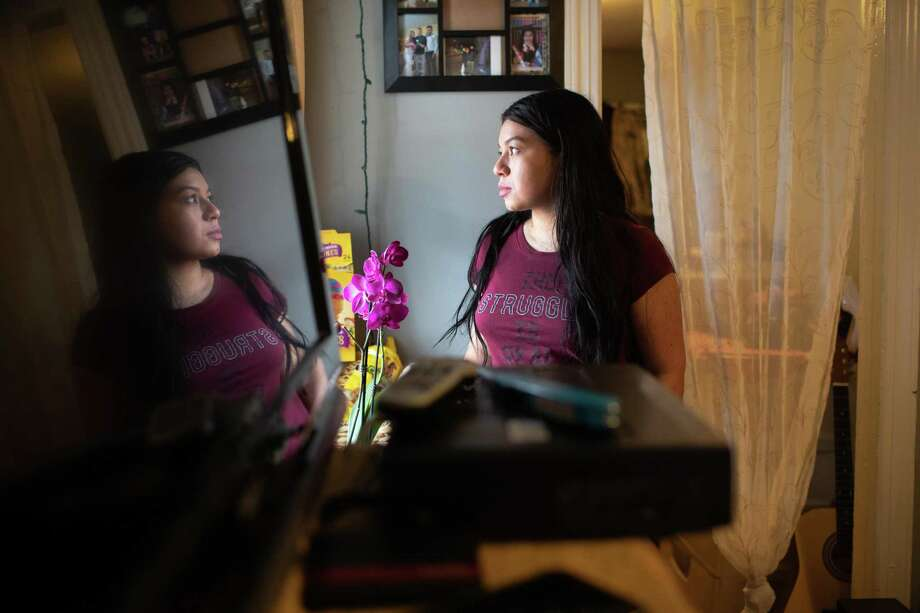 Undocumented immigrant Juana, 24, from El Salvador looks from her one-room apartment on March 25, 2020 in Norwalk. Photo: Photo By John Moore /Getty Images / Getty Images / 2020 Getty Images