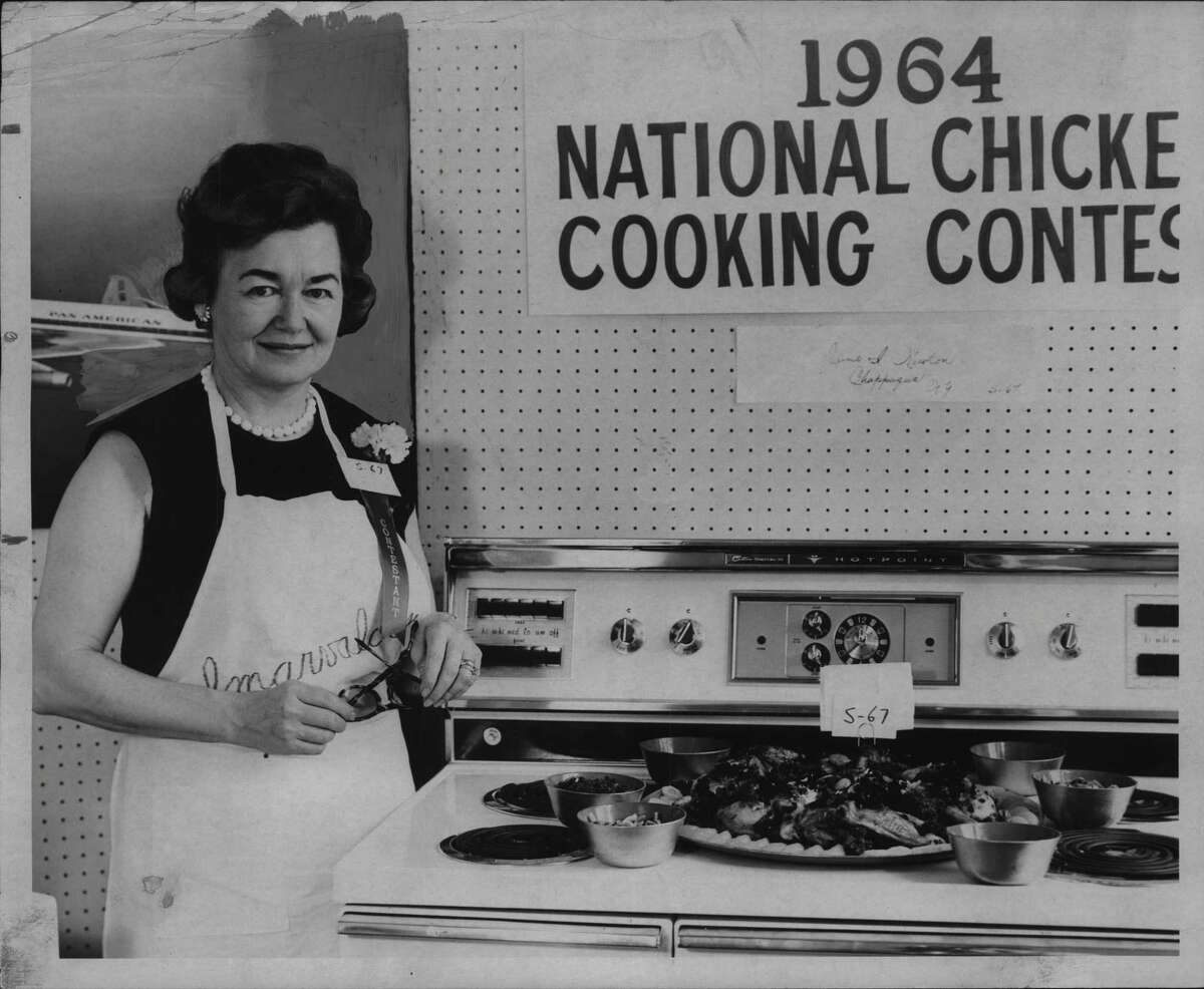 Mrs. Lawrence Newton with Chicken Cooking contest entry. 1964 (Robert D. Bennett/Times Union Archive)