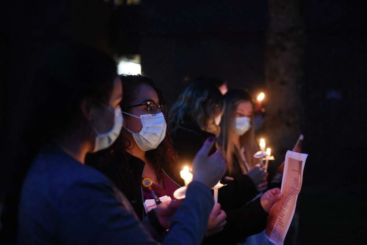 Nurses and staff from St. Peter's Health Partners line South Manning Boulevard outside St. Peter's Hospital where they held a candle lighting ceremony in celebration of National Nurses Month on Wednesday night, May, 6, 2020, in Albany, N.Y. A similar event was held at Samaritan Hospital in Troy. Organizers hope that the ceremony shows that healthcare workers can serve as a guiding light through the COVID-19 pandemic. (Will Waldron/Times Union)