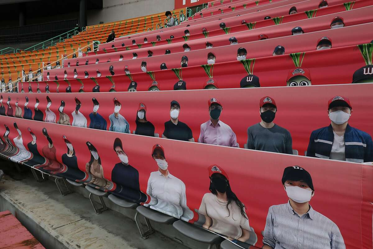 INCHEON, SOUTH KOREA - MAY 05: (EDITORIAL USE ONLY) The stands at SK Wyverns club's Happy Dream Ballpark, are filled with placards featuring their fans during the Korean Baseball Organization (KBO) League opening game between SK Wyverns and Hanwha Eagles