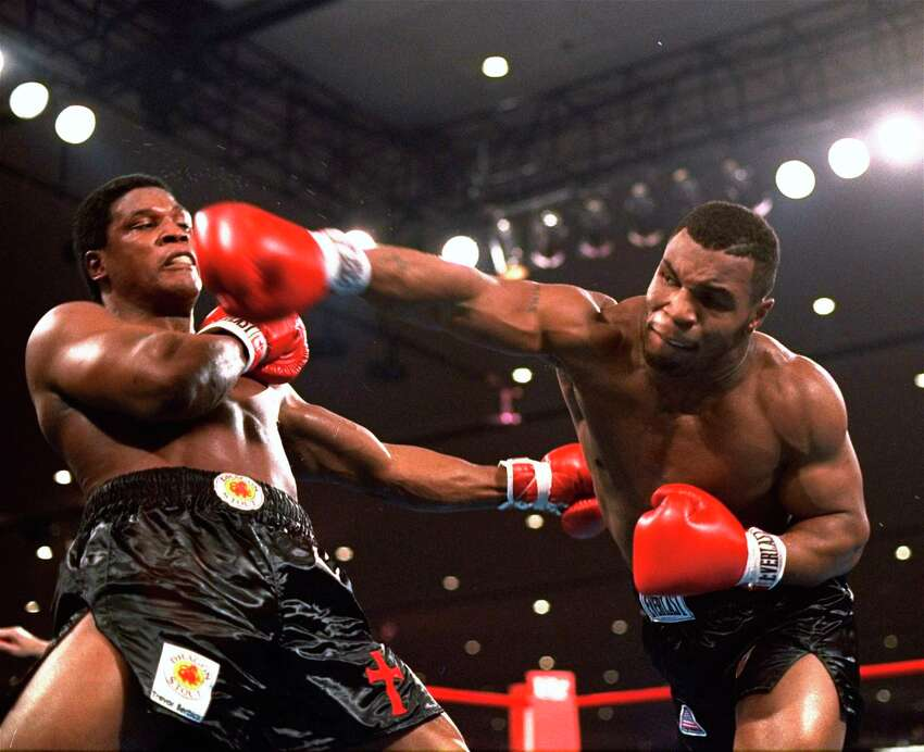 In this Nov. 22, 1986, file photo, Mike Tyson, right, delivers a blow to Trevor Berbick during a boxing bout in Las Vegas. Tyson hasna€™t announced any plans to return to the ring, though he did suggest on an Instagram post he might make himself available for 3 or 4-round exhibitions if the price was right. And already some people in Australia are talking about offering him $1 million to fight an exhibition against a rugby star or two. (AP Photo/Douglas C. Pizac, File)