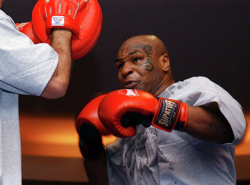 In this Aug. 30, 2006, file photo, former heavyweight boxing champion Mike Tyson spars during a training exhibition in Las Vegas. Tyson hasna€™t announced any plans to return to the ring, though he did suggest on an Instagram post he might make himself available for 3 or 4-round exhibitions if the price was right. And already some people in Australia are talking about offering him $1 million to fight an exhibition against a rugby star or two. (AP Photo/Marlene Karas, File)
