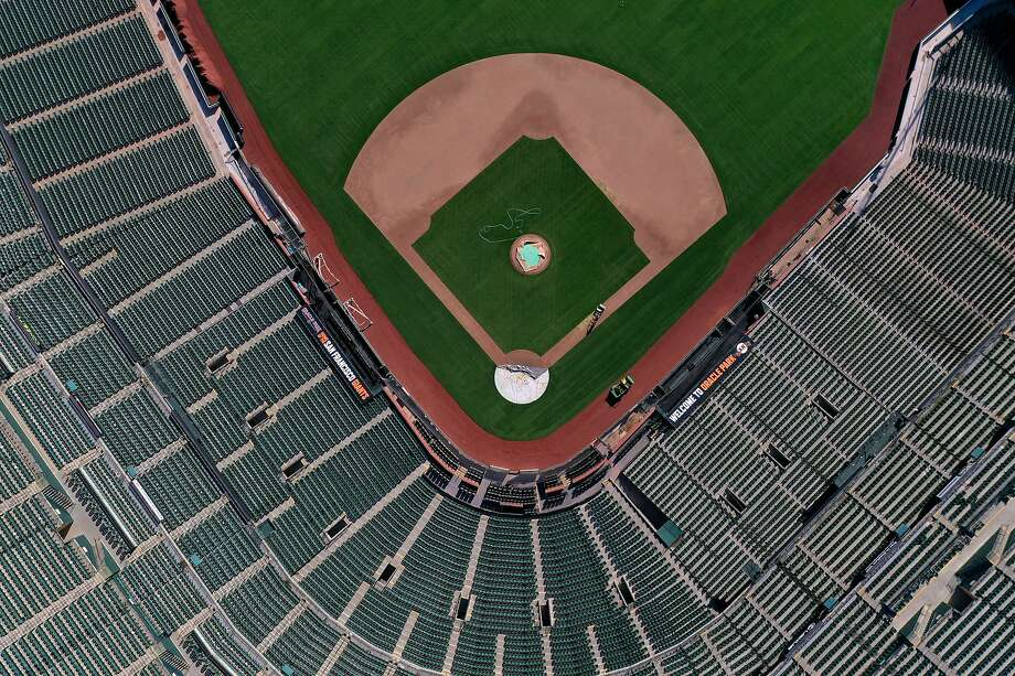 SAN FRANCISCO, CALIFORNIA - MARCH 26: An aerial view from a drone shows Oracle Park, home of the San Francisco Giants, empty on what would have been Opening Day March 26, 2020 in San Francisco, California. Photo: Justin Sullivan, Getty Images