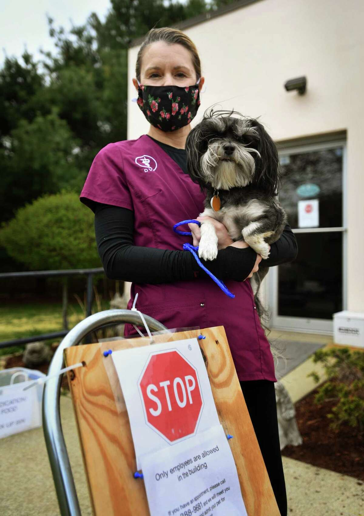 Veterinarian Suzanne Magruder, DVM, owner of Saybrook Veterinary Hospital, with her dog Dexter in Old Saybrook, Conn. on Wednesday, May 6, 2020.