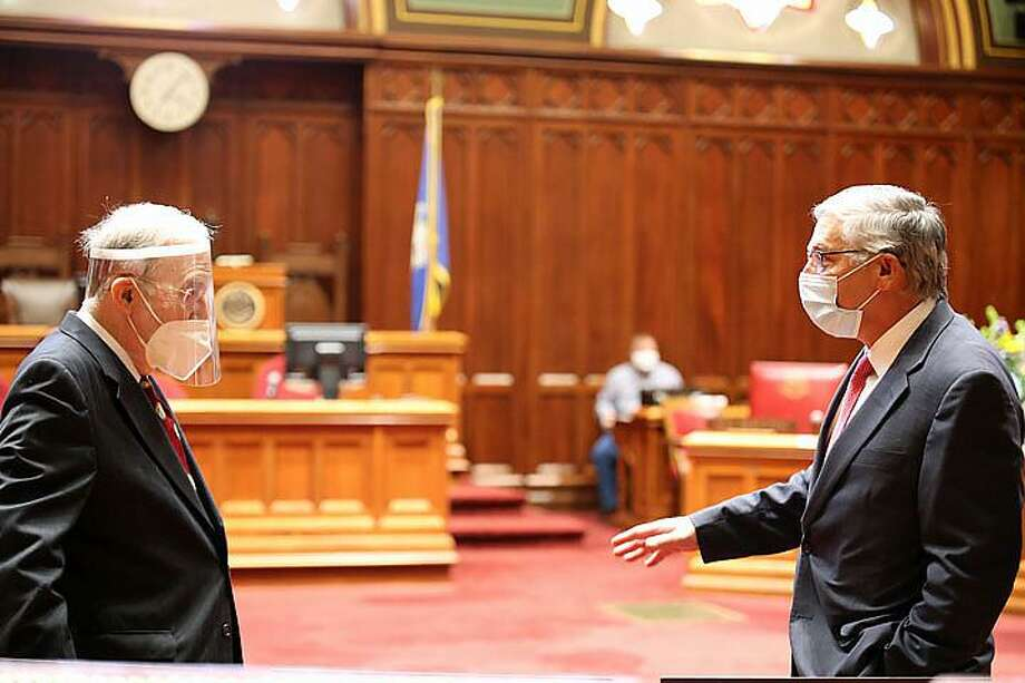 Sen. Martin Looney, left, Senate president pro-tem, with Sen. Len Fasano, R-North Haven, on Fasano's last day in a regular session as Senate minority leader as coronavirus rendered the 2020 session a non-event. Fasano is not seeking re-election. Photo: Christine Stuart/CT News Junkie
