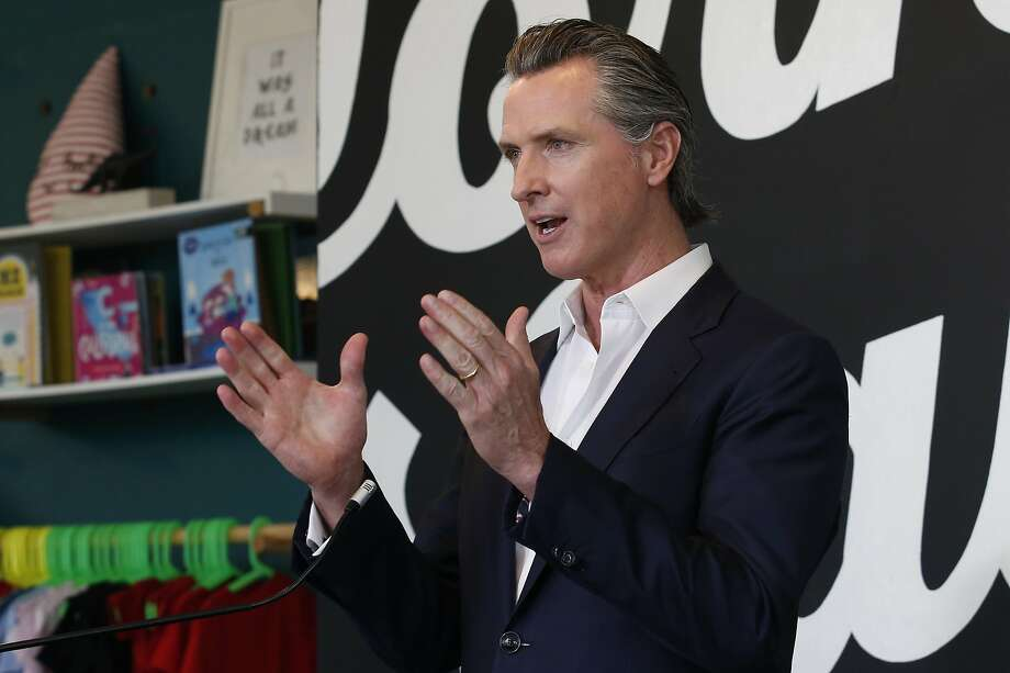 FILE - In this Tuesday, May 5,2020. file photo Gov. Gavin Newsom discusses his plan for the gradual reopening of California businesses during a news conference at the Display California store in Sacramento, Calif. Newsom on Wednesday, May 6, 2020, said he is issuing an executive order allowing employees across California's economy to apply for worker's compensation if they contract the coronavirus, with a presumption that it was work-related unless employers can prove otherwise. Photo: Rich Pedroncelli / Associated Press