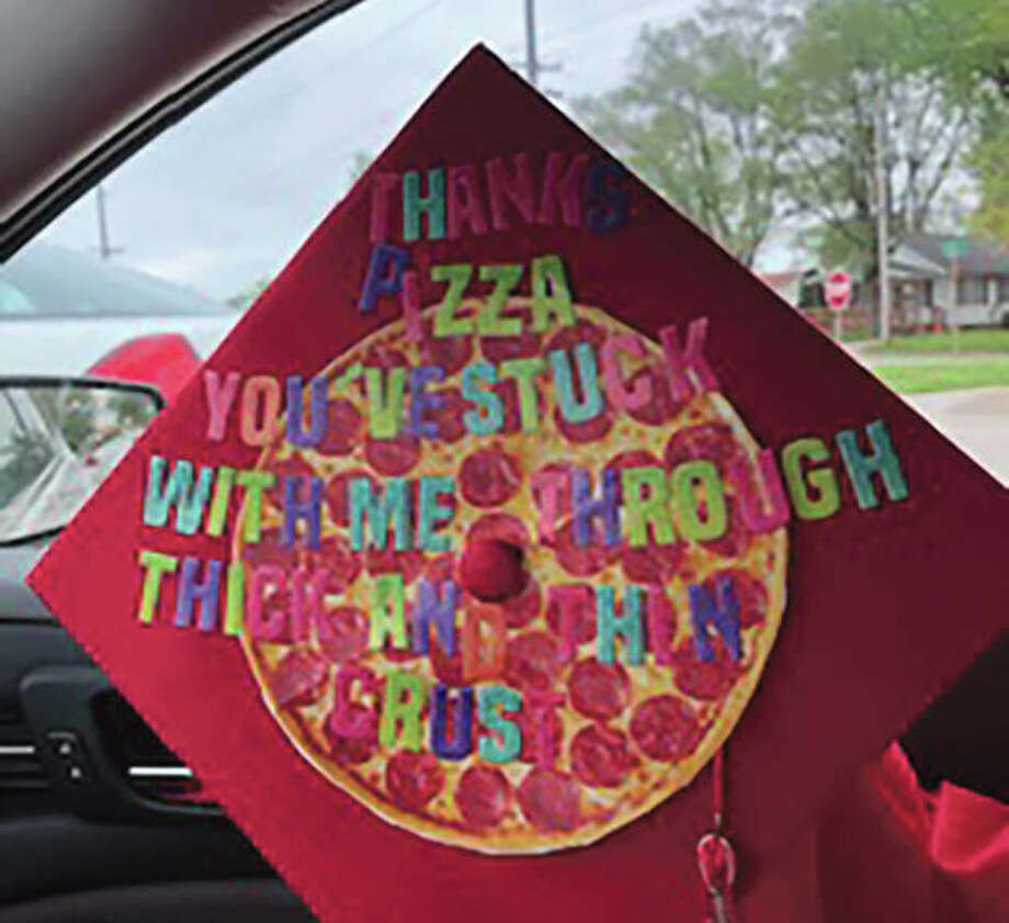 """Devin Ussery's graduation cap shows his appreciation for pizza. """"Thanks, pizza. You've stuck with me through thick and thin crust,"""" it reads. Photo: Photo Provided"""