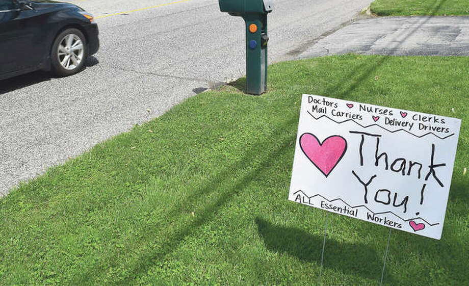 A front-porch sign thanking essential workers is displayed in front of Max Nelson's house. Photo: Marco Cartolano | Journal-Courier