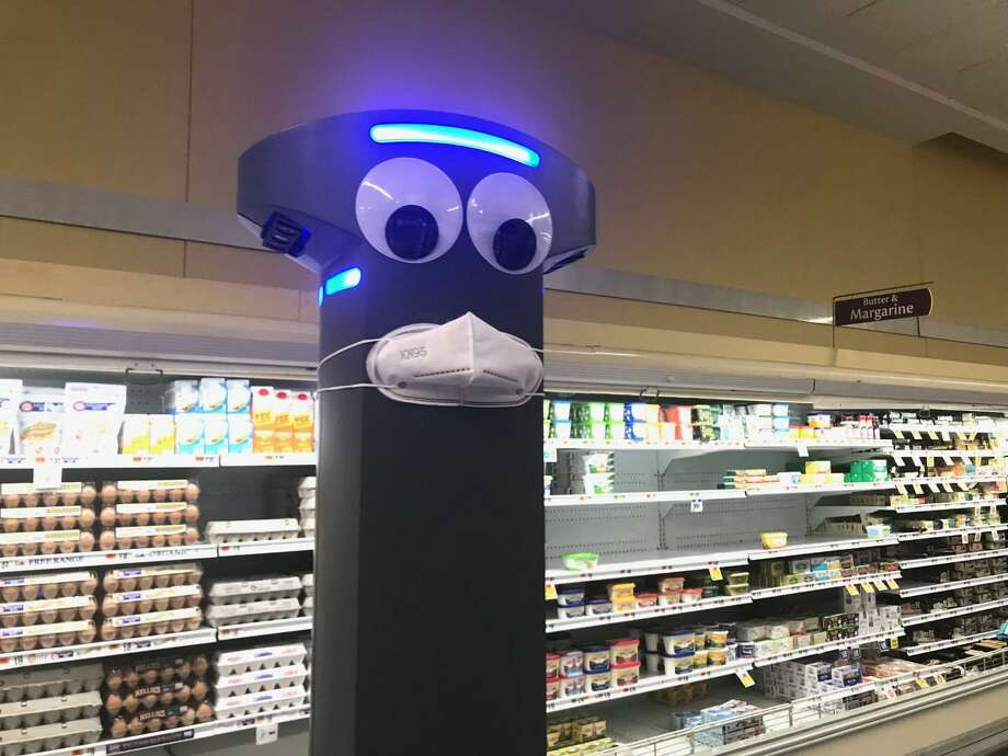 Stop & Shop's aisle-roaming robot - Marty - is outfitted with a protective mask at the supermarket's New Haven location. Photo: Contributed Photo