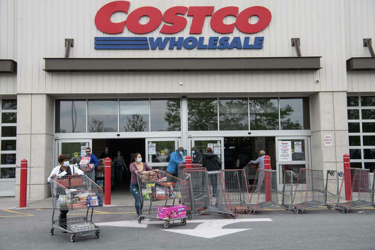Shoppers walk around one-way barriers at a Costco store in Washington, D.C., on May 5.