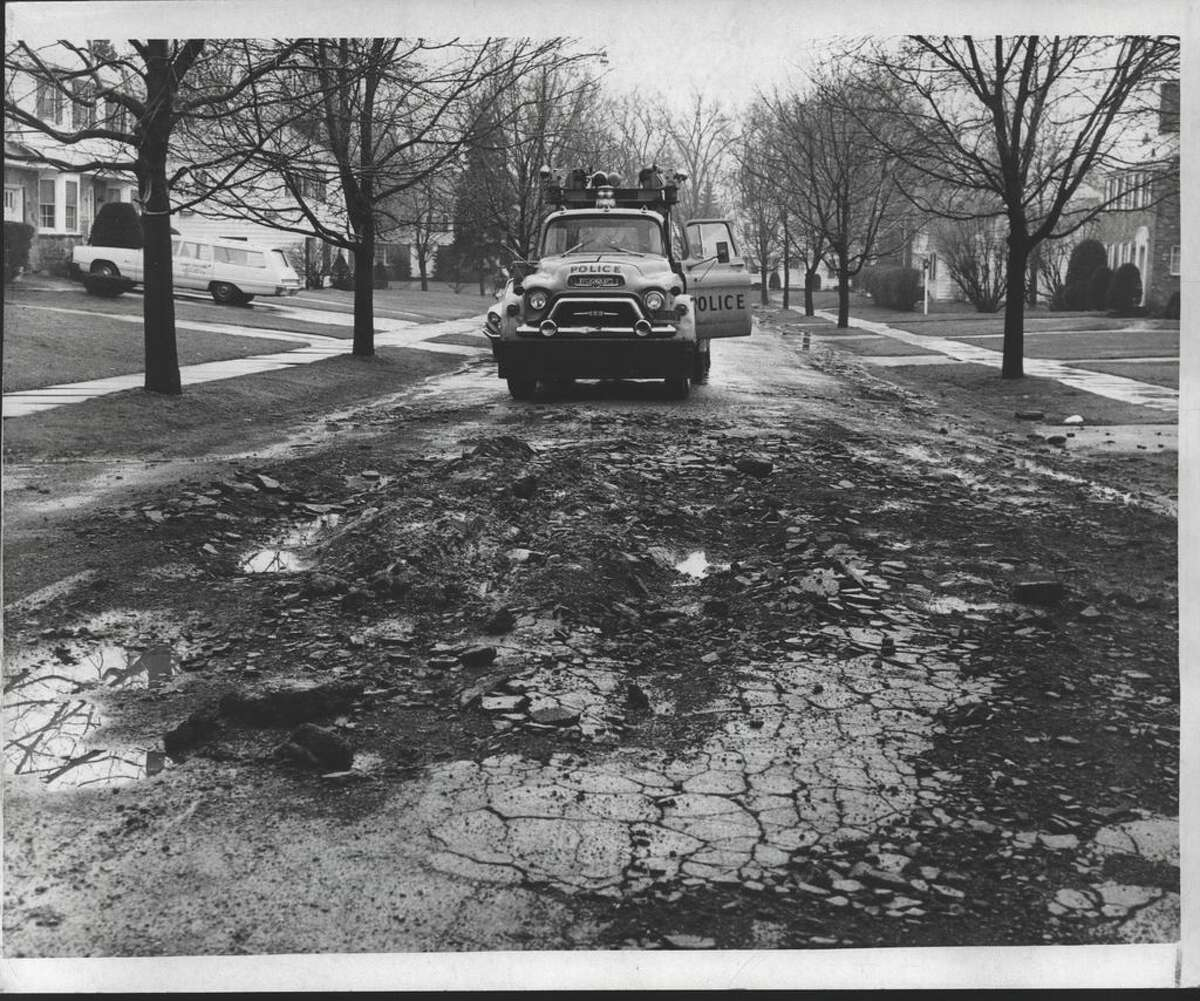 Albany New York Streets filled with potholes caused by frost, Holmsdale. May, 1967