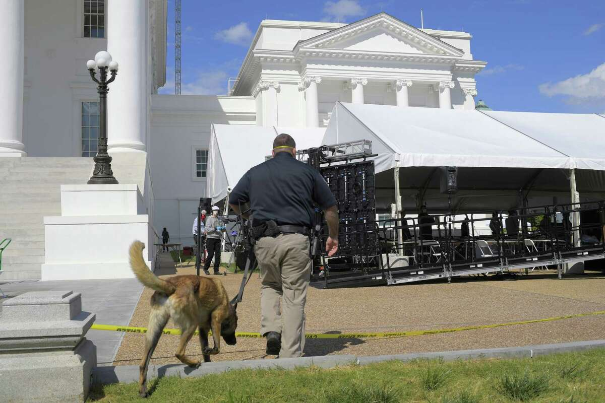 Virginia's House of Delegates met under a canopy outside the state Capitol in April as a precaution against the novel coronavirus. (