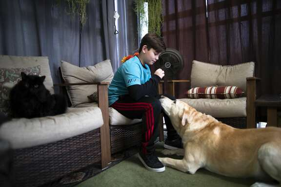 Gabriel Garza shares a moment with his dog who hopes to get a treat. After years of pressing the school and eventually hiring a special education advocate, school officials tested Gabriel at the end of fourth grade in 2019 and found he has both ADHD and is mildly autistic.