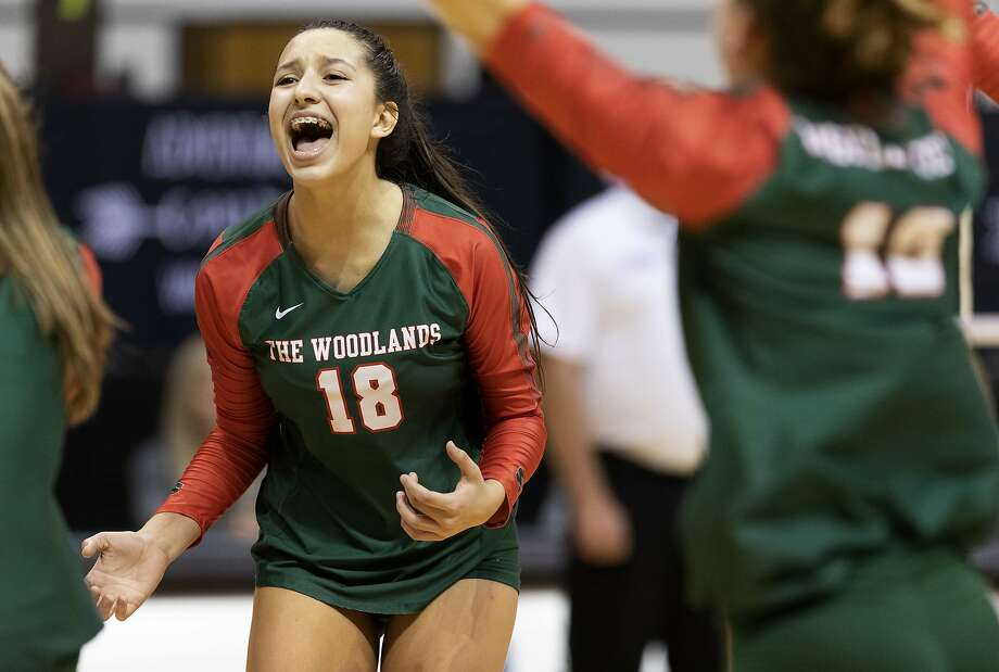 The Woodlands outside hitter Julieta Valdes (18) reacts after an ace by Dylan Maberry during the first set of a Region II-6A semifinal volleyball match at Sam Houston State University, Friday, Nov. 15, 2019, in Huntsville. Photo: Jason Fochtman, Staff Photographer