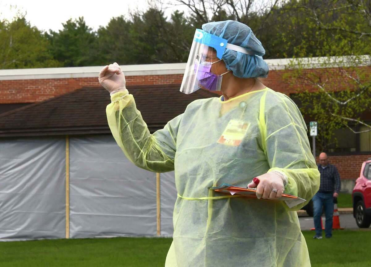 A healthcare worker directs a driver at a COVID-19 testing site behind Warren County Municipal Center on Thursday, May 7, 2020 in Queensbury, N.Y. (Lori Van Buren/Times Union)