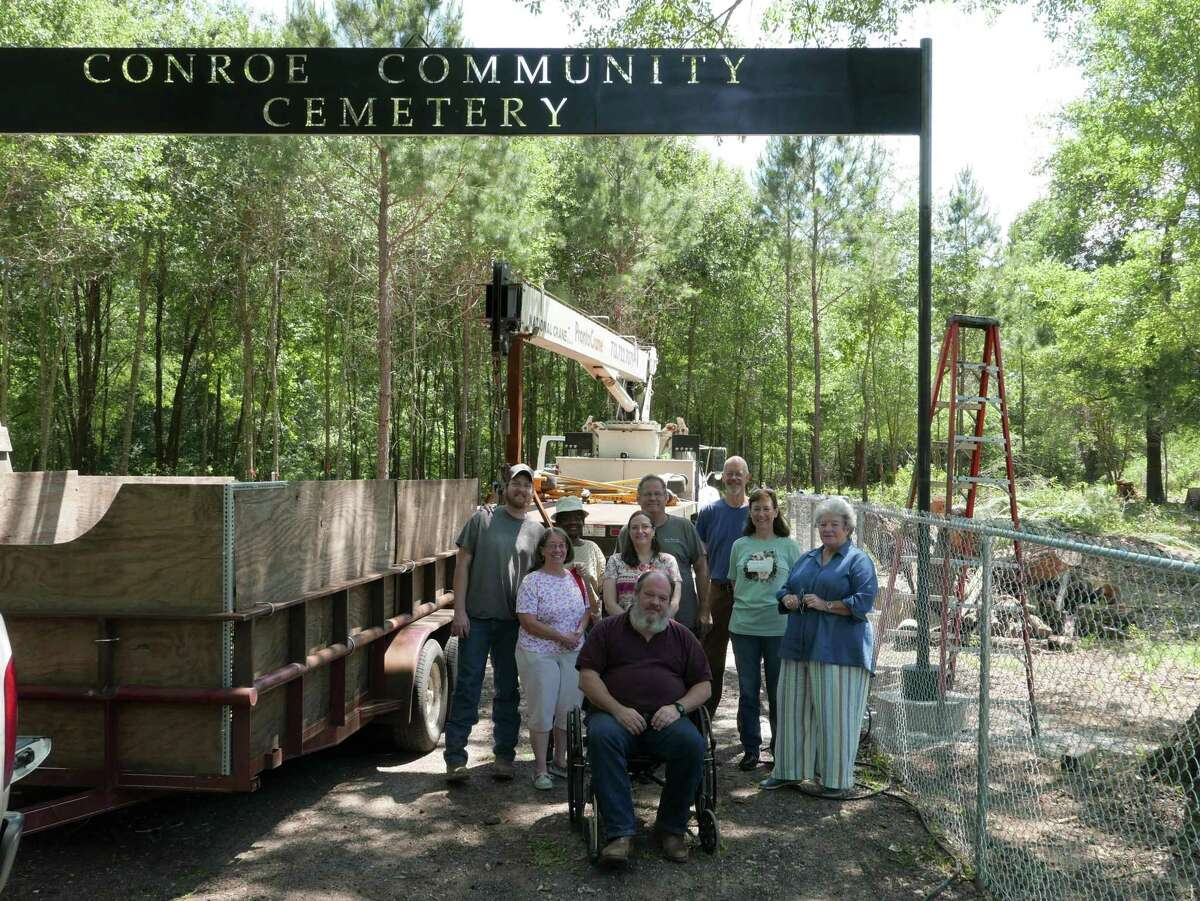 Pictured from left Brian Amburgey, Pam Ready, Fay Jones, Cindy Amburgey, Brian Amburgey, John Meredith, Wendy Packer and Ann Meador along with CCCRP President Jon Edens, at the front, gather to celebrate the installation of the cemetery sign on Wednesday.
