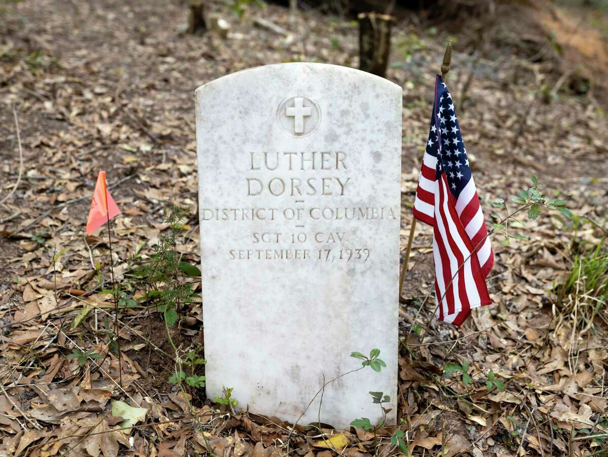 The grave marker for Luther Dorsey rests at the Conroe Community Cemetery along side a U.S. flag, Sunday, March 1, 2020.