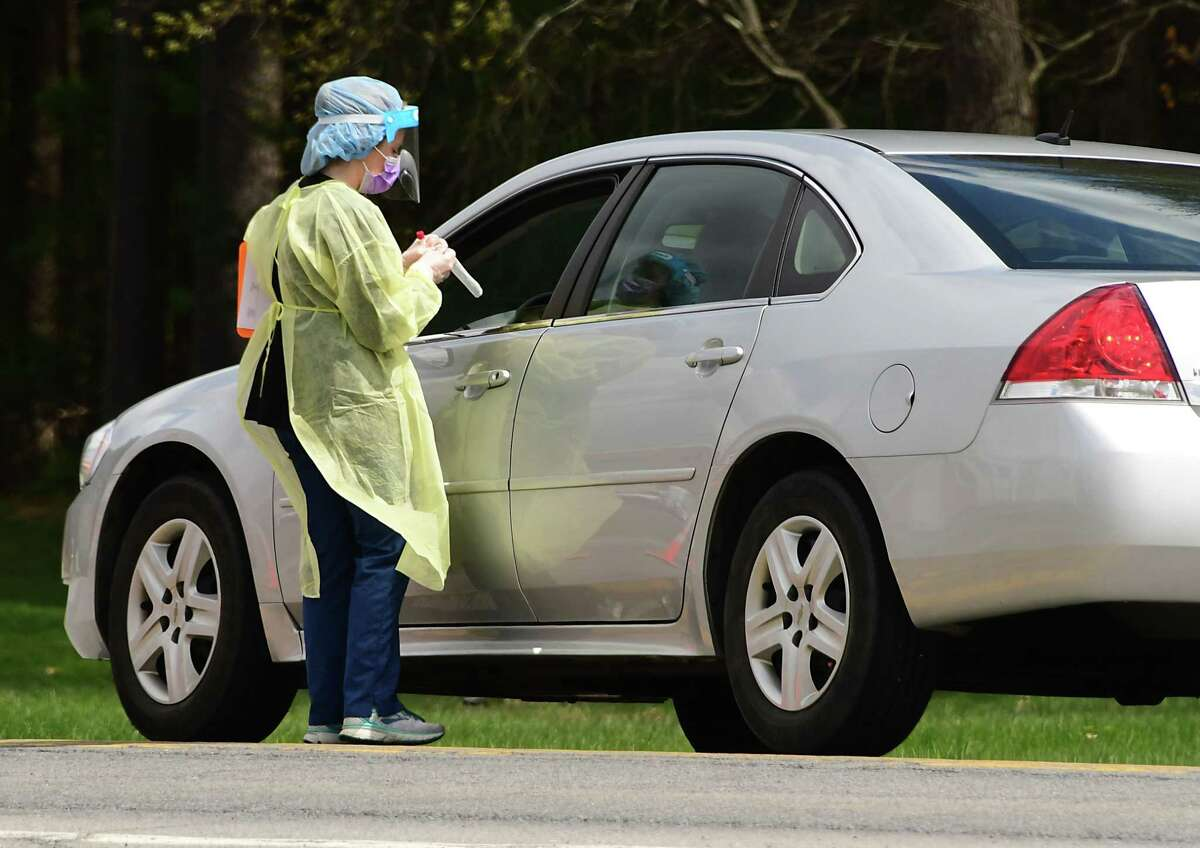 A healthcare worker gets ready to test a patient at a COVID-19 testing site behind Warren County Municipal Center on Thursday, May 7, 2020 in Queensbury, N.Y. (Lori Van Buren/Times Union)