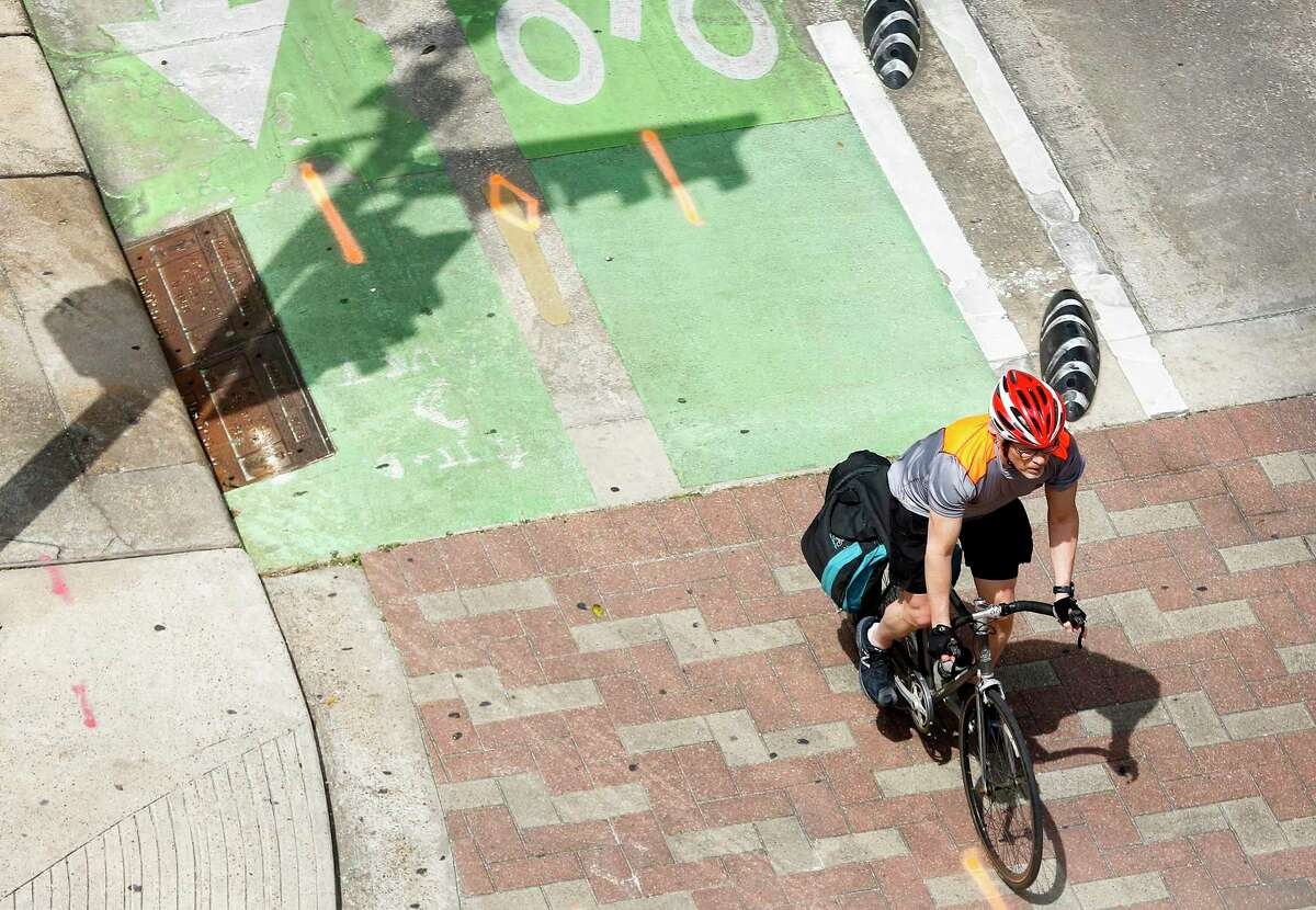 Cyclists near the corner of Milam and Lamar in downtown Houston on Thursday, March 19, 2020. Hourly bicycle rentals have increased as less cars on the road as most businesses close their offices due to social distancing in Houston