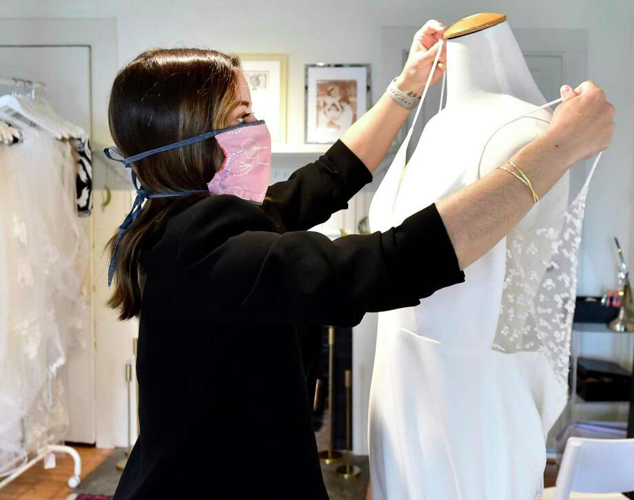 "Madison, Connecticut -Friday, May 1, 2020: Chelsea McNamara, owner of Everthine Bridal Boutique in Madison, a non-traditional ""fashion forward stylish bridal shop that encourages brides to ""step out of the box"" when choosing their gowns. McNamara, using appointments, conducts virtual visits with brides using Zoom. Photo: Peter Hvizdak / Hearst Connecticut Media / New Haven Register"